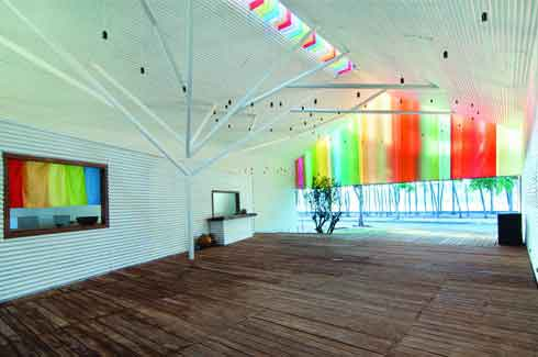 The multi-layer colourful curtains are arranged and placed in the opens to soften the coldness of the metal frames