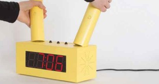 The Victory Alarm Clock is a yellow box-like structure that has attached two actuators