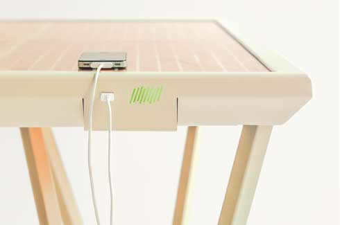 The table's orange-coloured, glass top writing surface consists of a solar panel which comes with two USB charging points