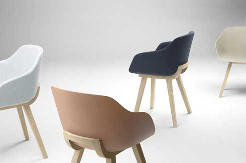 Bioplastic chairs consist of an enveloping shell, placed on a solid wood trestle that is cut out to optimise arm and back support