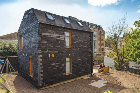 The Waste House installed at the University of Brighton, UK is almost exclusively made from discarded waste