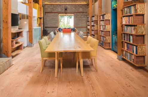 Spruce-Pine-Fir (SPF) short spans finger-joint to achieve an economical 16-feet long table. Rustic flooring shown is in Douglas-fir wood
